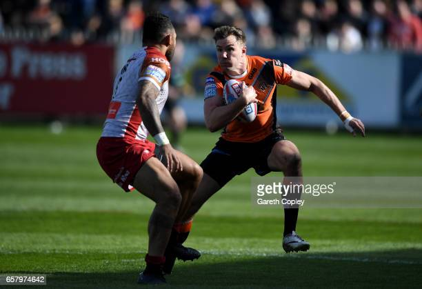 Michael Shenton of Castleford looks to get past Krisnan Inu of Catalans during the Betfred Super League match between Castleford Tigers and Catalans...