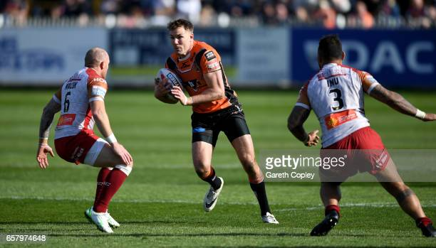 Michael Shenton of Castleford looks to get past Luke Walsh and Krisnan Inu of Catalans during the Betfred Super League match between Castleford...