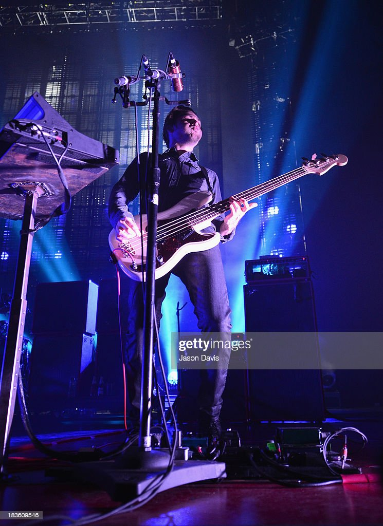 Michael Shuman of Queens of the Stone Age performs at Nashville Municipal Auditorium on October 7, 2013 in Nashville, Tennessee.
