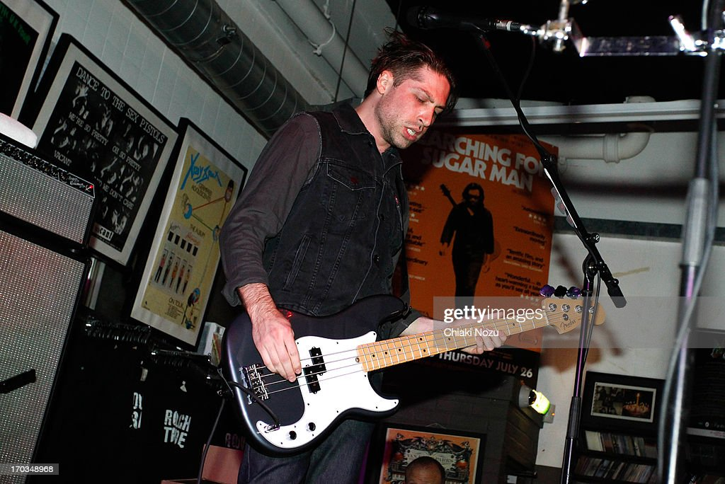 Michael Shuman of Queens of the Stone Age performs at Rough Trade East on June 11, 2013 in London, England.