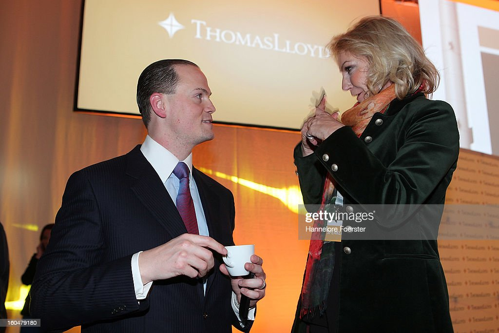Michael Sieg, Chairman and CEO of ThomasLloyd Group, and moderator Sabine Christiansen, speak at the Thomas Lloyd Cleantech Congress, on February 1, 2013 in Frankfurt am Main, Germany. Technology and trends in renewable energies are up for discussion during the congress.