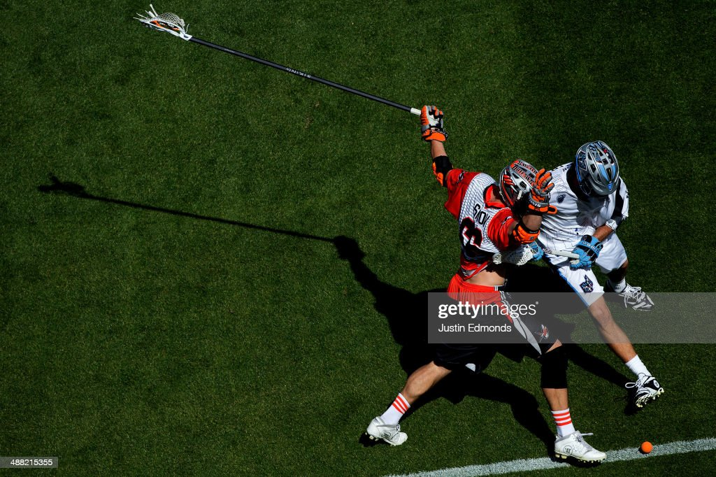 Michael Simon #66 of the Denver Outlaws and Kevin Cooper #40 of the Ohio Machine battle for a ground ball during the second quarter at Sports Authority Field at Mile High on May 4, 2014 in Denver, Colorado. The teams wore Star Wars themed jerseys in honor of 'May-The-4th-Be-With-You' day.