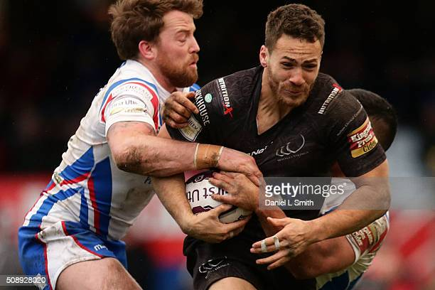 Michael Sio of Wakefield Wildcats assists Danny Kirmond in tackling Eamon OÕCarroll of Widnes Vikings during the First Utility Super League Round One...