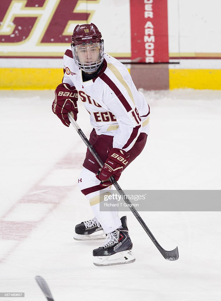 Michael Sit #18 of the Boston College Eagles looks for the puck during NCAA hockey action against the New Hampshire Wildcats at Kelley Rink on December 6, 2013 in Chestnut Hill, Massachusetts.