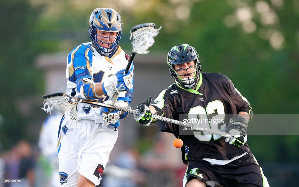 Michael Skudin #92 of the New York Lizards battles for a loose ball against <a gi-track='captionPersonalityLinkClicked' href=/galleries/search?phrase=Kevin+Drew+-+Lacrosse+Player&family=editorial&specificpeople=14832467 ng-click='$event.stopPropagation()'>Kevin Drew</a> #19 of the Charlotte Hounds during their Major League Lacrosse game at Shuart Stadium on May 31, 2013 in Uniondale, New York.