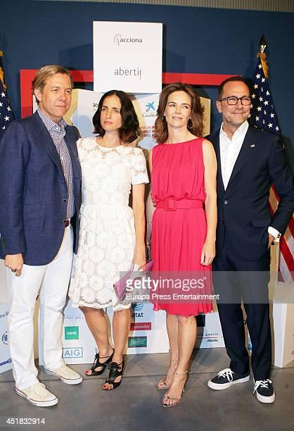 Michael Smith Carolina Adriana Herrera Miriam Ungria and USA ambassador James Costos attend Independence Day on July 4 2014 in Madrid Spain