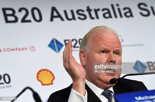 Michael Smith CEO of Australian banking giant ANZ speaks during a press briefing during the B20 summit in Sydney on July 16 2014 Business leaders...
