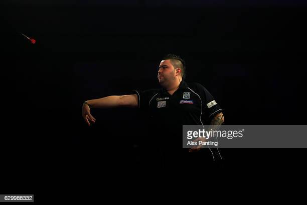 Michael Smith of England throws during his first round match against Ricky Evans of England during day one of the 2017 William Hill PDC World Darts...