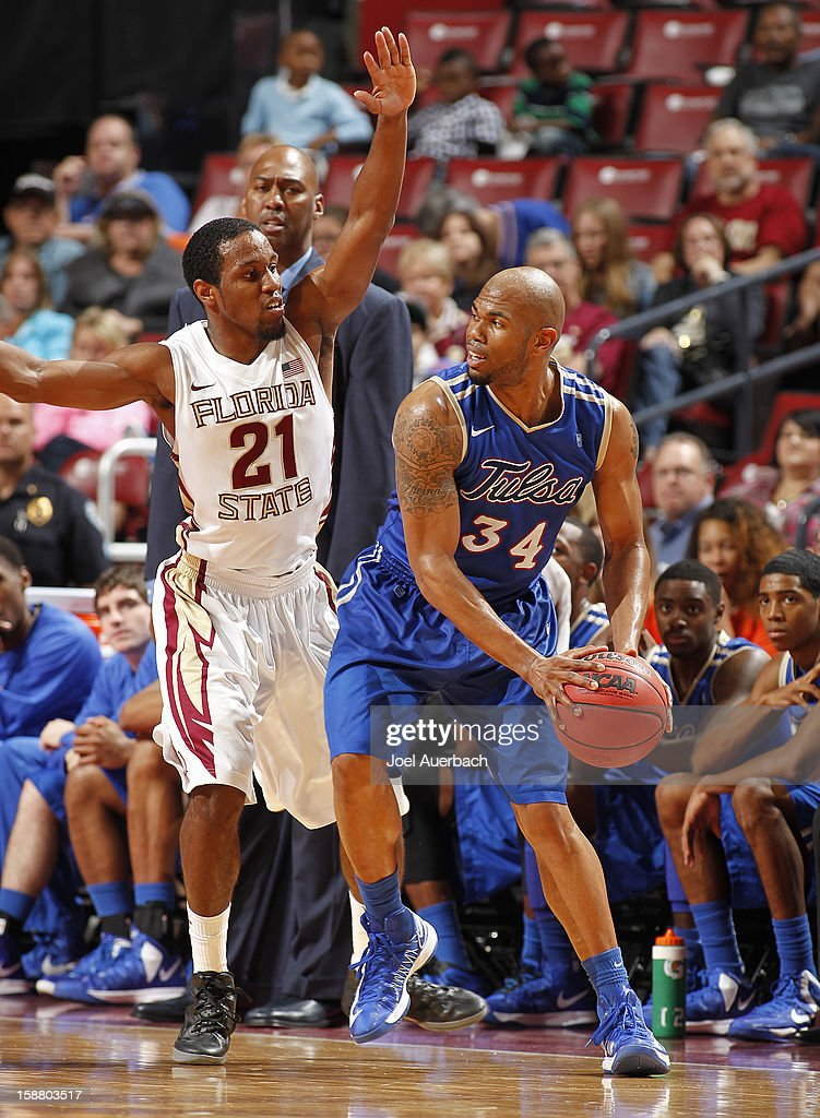 Michael Snaer #21 of the Florida State Seminoles defends against Scottie Haralson #34 of the Tulsa Golden Hurricane at the MetroPCS Orange Bowl Basketball Classic on December 29, 2012 at the BB&T Center in Sunrise, Florida. The Seminoles defeated the Golden Hurricane 82-63