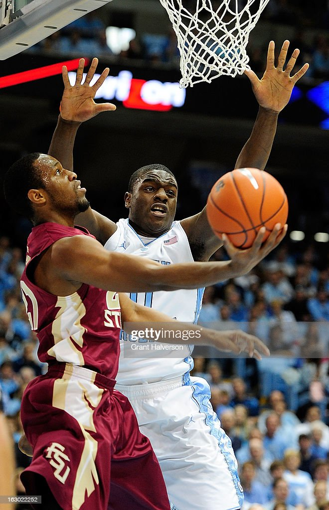 Michael Snaer #11 of the Florida State Seminoles drives against Joel James #0 of the North Carolina Tar Heels during play at Dean Smith Center on March 3, 2013 in Chapel Hill, North Carolina. North Carolina won 79-58.