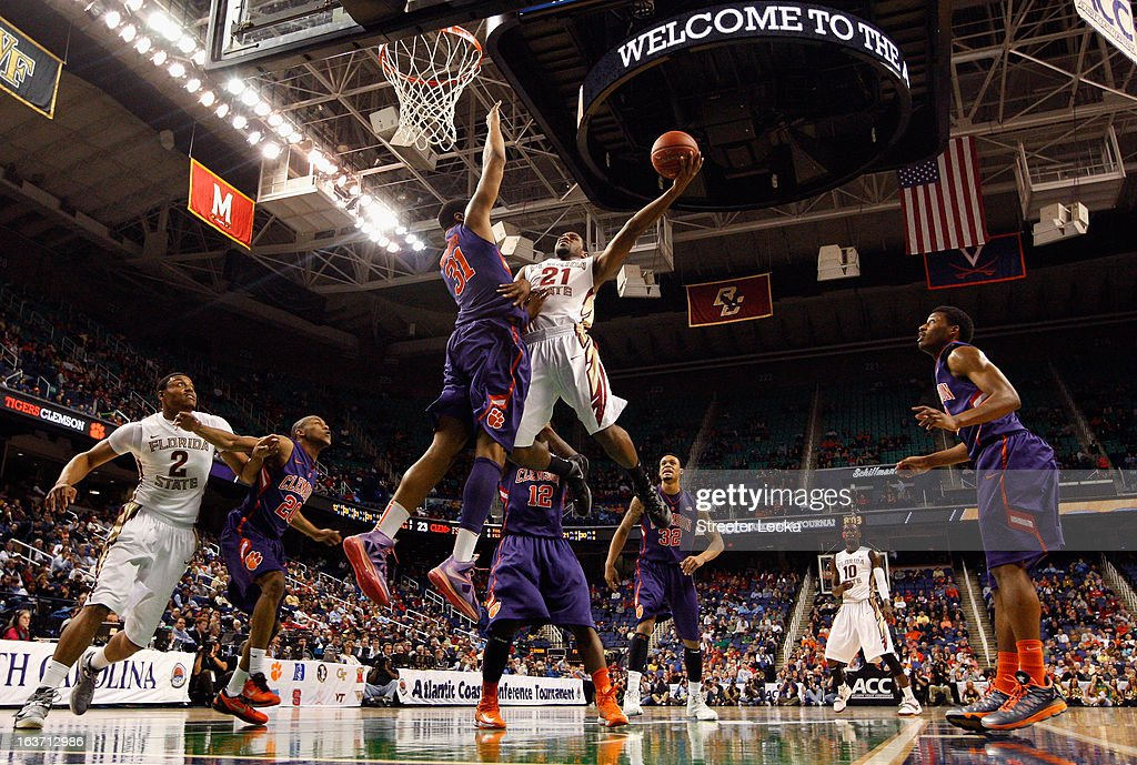 Michael Snaer #21 of the Florida State Seminoles drives to the basket against Devin Booker #31 of the Clemson Tigers during the first round of the Men's ACC Basketball Tournament at Greensboro Coliseum on March 14, 2013 in Greensboro, North Carolina.