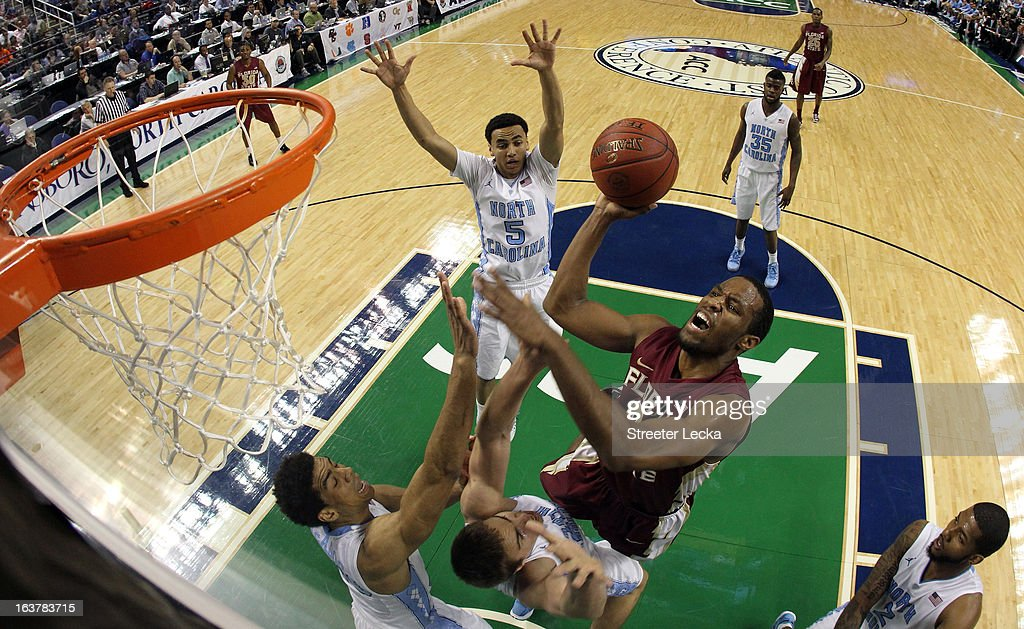 Michael Snaer #21 of the Florida State Seminoles drives to the basket against the North Carolina Tar Heels during the quarterfinals of the Men's ACC Basketball Tournament at Greensboro Coliseum on March 15, 2013 in Greensboro, North Carolina.