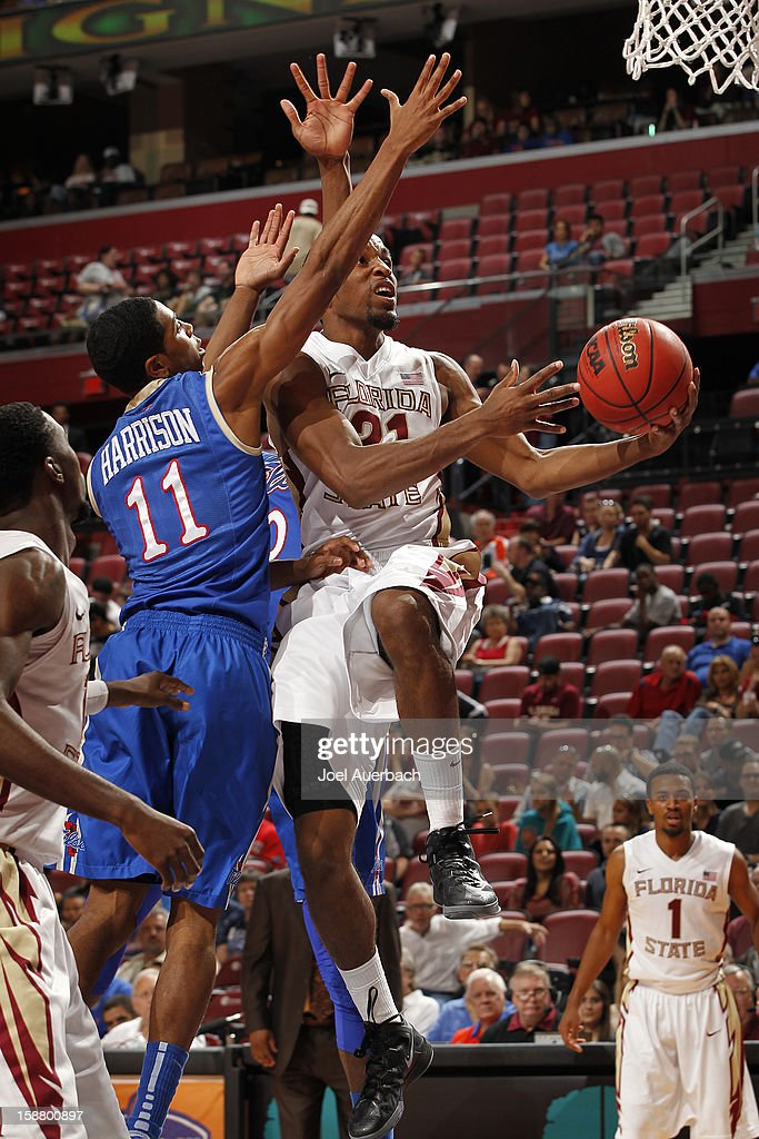 Michael Snaer #21 of the Florida State Seminoles goes to the basket past Shaquille Harrison #11 of the Tulsa Golden Hurricane at the MetroPCS Orange Bowl Basketball Classic on December 29, 2012 at the BB&T Center in Sunrise, Florida. The Seminoles defeated the Golden Hurricane 82-63.