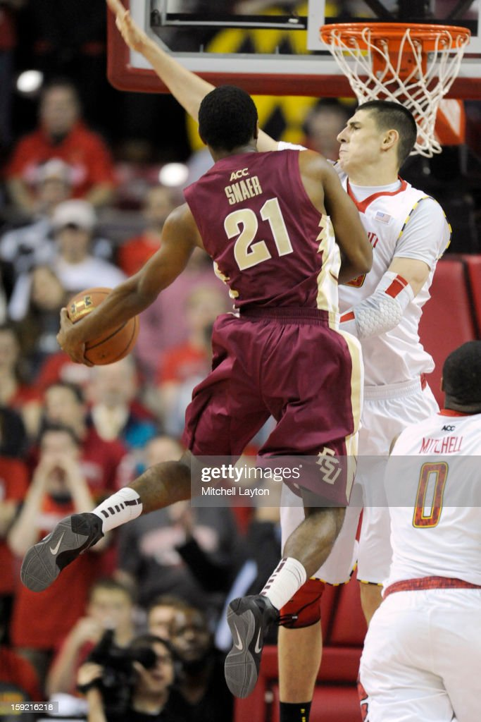 Michael Snaer #21 of the Florida State Seminoles takes a shot around Alex Len #25 of the Maryland Terrapins during a college basketball game on January 9, 2013 at the Comcast Center in College Park, Maryland.