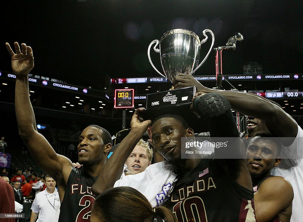 Michael Snaer #21, Okaro White #10, and Ian Miller #30 celebrate after the championship game of the Coaches Vs. Cancer Classic, the Seminoles defeated the Saint Joseph's Hawks 73-66 at the Barclays Center on November 17, 2012 in the Brooklyn borough of New York City.