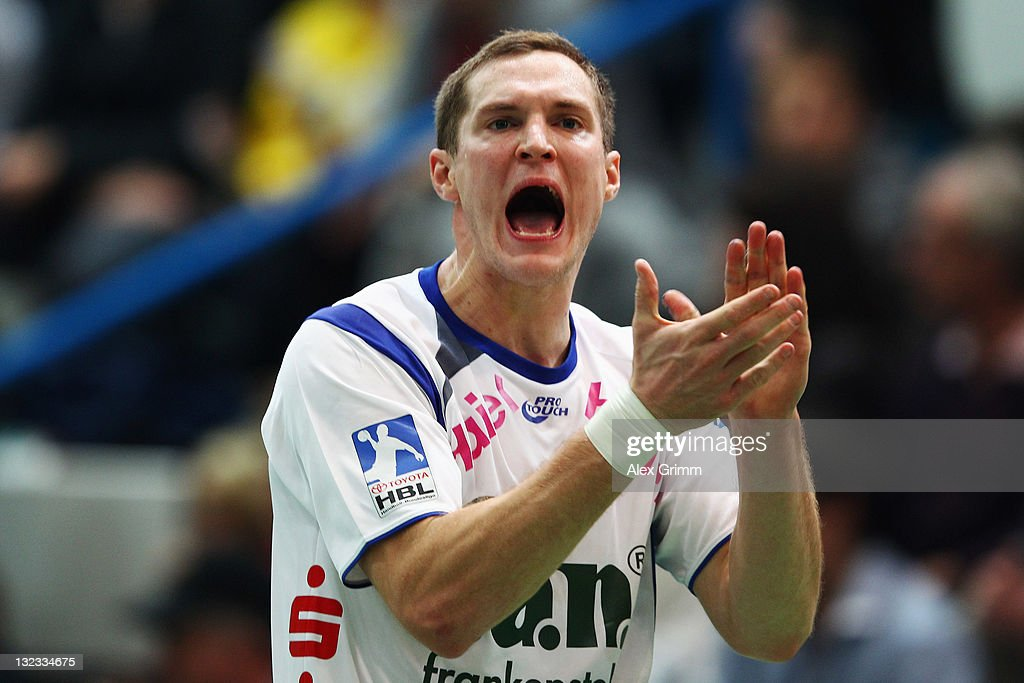 Michael Spatz of Grosswallstadt applauds during the Toyota Handball Bundesliga match between T VGrosswallstadt and MT Melsungen at f.a.n. frankenstolz arena on November 11, 2011 in Aschaffenburg, Germany.