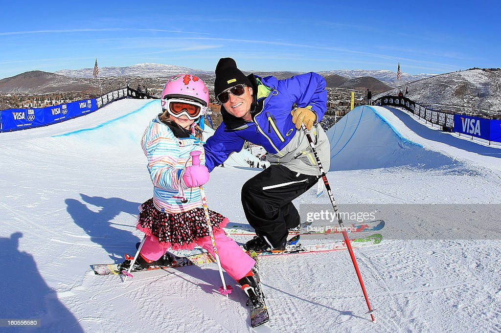 Michael Spencer of EGO Sports Management and his daughter Zali, 4, prepare to ski down the halfpipe prior to the finals of the FIS Freestyle Ski Halfpipe World Cup during the Sprint U.S. Grand Prix at Park City Mountain on February 2, 2013 in Park City, Utah.