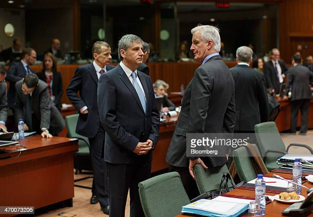 Michael Spindelegger Austria's finance minister center speaks with Michel Barnier the financial services chief for the European Union ahead of the...
