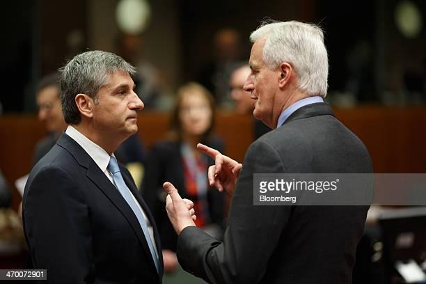 Michael Spindelegger Austria's finance minister left listens as Michel Barnier financial services commissioner for the European Union speaks ahead of...