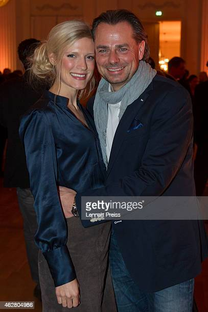 Michael Sporer and his girlfriend Lisa Brilla pose during the Salvatore Ferragamo Emozione Fragrance Launch event at Residenz on February 5 2015 in...
