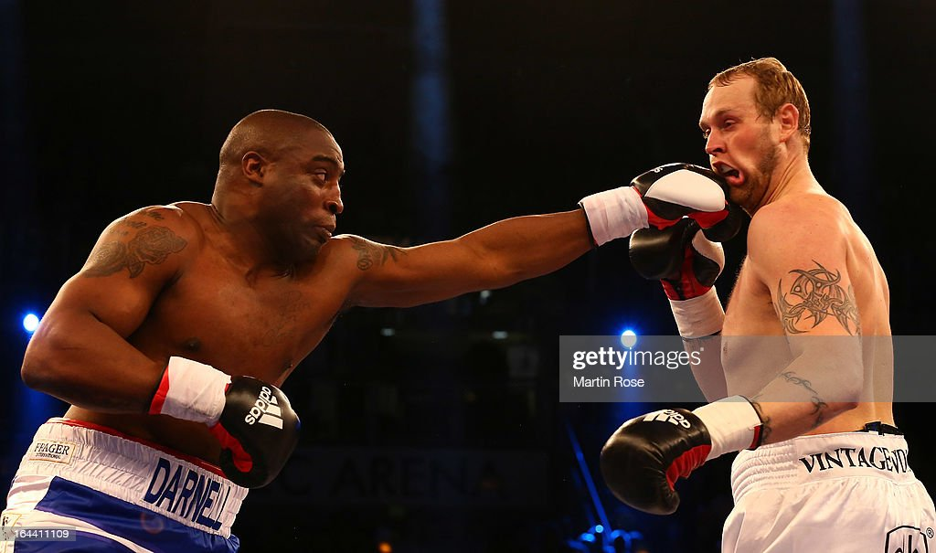 Michael Sprott (L) of England and Robert Helenius (R) of Finland exchange punches during the Heavyweight fight at Getec Arena on March 23, 2013 in Magdeburg, Germany.
