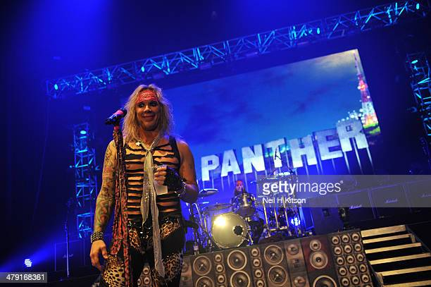 Michael Starr of Steel Panther performs on stage at Manchester Apollo on March 16 2014 in Manchester United Kingdom