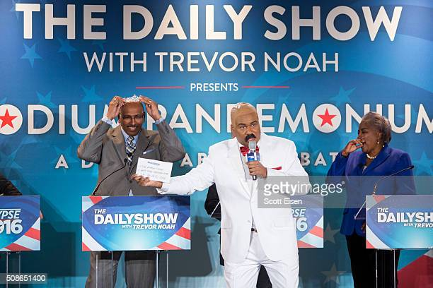 Michael Steele Former Chairman of the Republican National Committee left holds a tiara next to Roy Wood Jr Daily Show Correspondent and Donna Brazile...