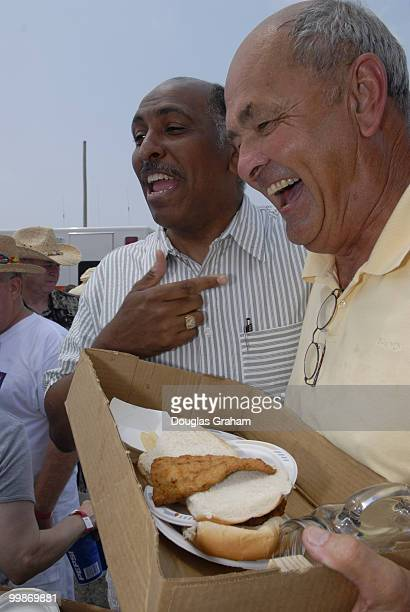 Michael Steele has a laugh with Donnie Drewer during the 30th annual J Millard Tawes Crab and Clam Bake in Crisfield Maryland