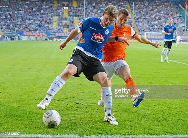 Michael Stegmayer of Darmstadt tackles Fabian Klos of Bielefeld during the Second Bundesliga Playoff Second Leg match between Arminia Bielefeld and...
