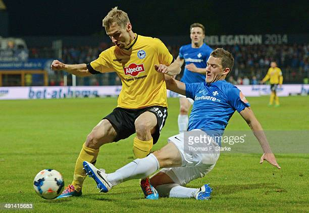 Michael Stegmayer of Darmstadt tackles Sebastian Hille of Bielefeld during the Second Bundesliga Playoff First Leg match between Darmstadt 98 and...
