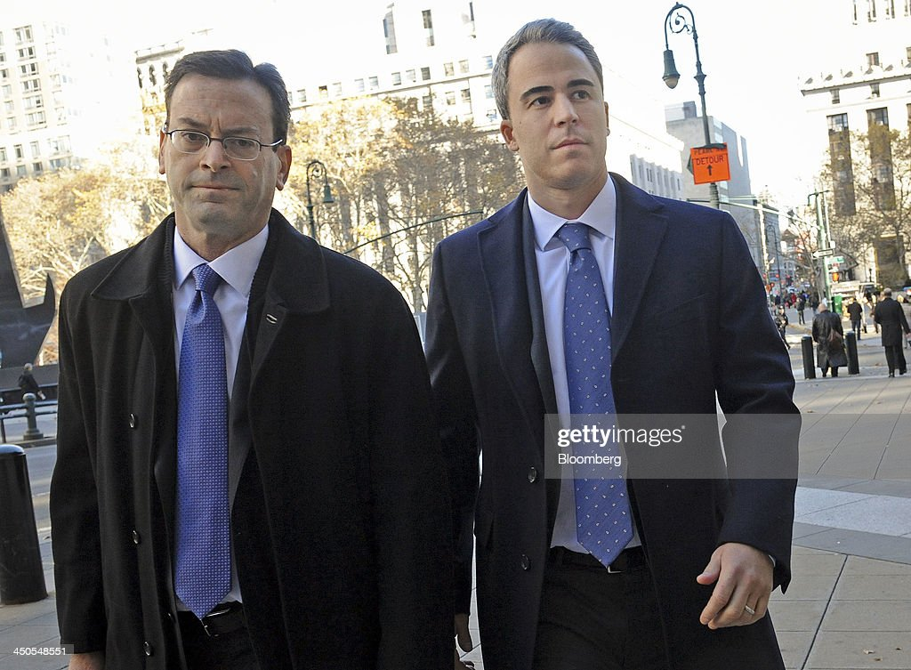 Michael Steinberg, a portfolio manager with SAC Capital Advisors LP, right, arrives with attorney Barry Berke at federal court in New York, U.S., on Tuesday, Nov. 19, 2013. Assistant U.S. Attorneys Antonia Apps and Harry Chernoff say Steinberg reaped more than $1.4 million in illicit profits for the Stamford, Connecticut-based fund. Photographer: Louis Lanzano/Bloomberg via Getty Images