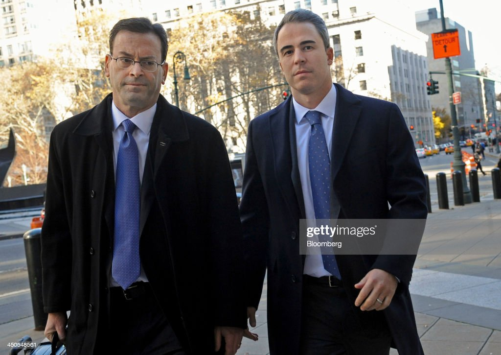 Michael Steinberg, a portfolio manager with SAC Capital Advisors LP, right, arrives at federal court with attorney Barry Berke in New York, U.S., on Tuesday, Nov. 19, 2013. Assistant U.S. Attorneys Antonia Apps and Harry Chernoff say Steinberg reaped more than $1.4 million in illicit profits for the Stamford, Connecticut-based fund. Photographer: Louis Lanzano/Bloomberg via Getty Images