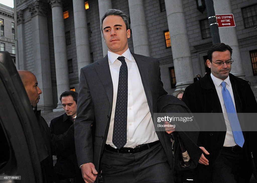 Michael Steinberg, a portfolio manager with SAC Capital Advisors LP, center, exits federal court with attorney Barry Berke, right, in New York, U.S., on Wednesday, Dec. 18, 2013. Steinberg became the fund's longest-serving manager to be convicted of insider trading in a government victory that may increase pressure on his former colleague, Mathew Martoma, to cooperate in the U.S. investigation of founder Steven A. Cohen. Photographer: Louis Lanzano/Bloomberg via Getty Images