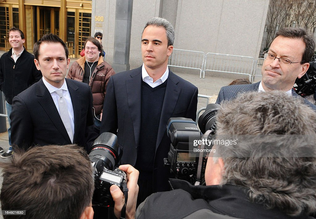 Michael Steinberg, SAC Capital Advisors LP fund manager, who worked at SAC's Sigma Capital Management unit, center, exits federal court in New York, U.S., on Friday, March 29, 2013. Steinberg was indicted by a federal grand jury on five counts of conspiracy and securities fraud as the U.S. government's wide ranging probe of insider trading at the $15 billion firm got one step closer to founder Steven A. Cohen. Photographer: Jonathan Fickies/Bloomberg via Getty Images