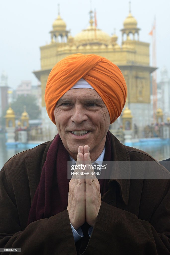 Michael Steiner, German Ambassador to India, poses at the Sikh Shrine Golden Temple in Amritsar on January 1, 2013. Devotees from across India and abroad are paying obeisance on the occasion of New Year at the temple in northern India.