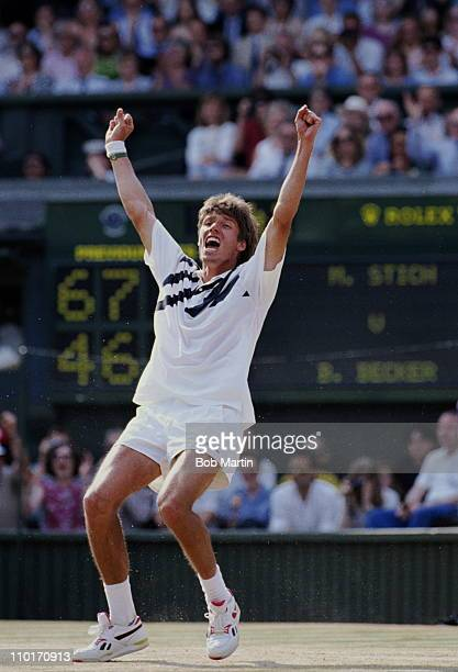 Michael Stich of Germany falls to his knees and raises his arms in triumph to become champion after defeating Boris Becker during their Men's Singles...