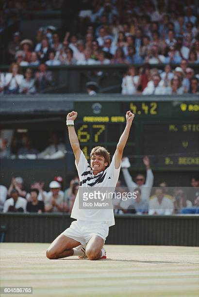 Michael Stich of Germany holds his arms aloft after winning the Men's Singles Final of the Wimbledon Lawn Tennis Championship against Boris Becker on...