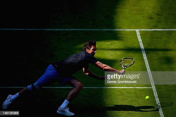 Michael Stich of Germany plays a backhand in his match with Martina Navratilova of USA against Stefan Edberg of Sweden and Anastasia Myskina of...