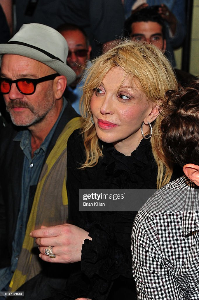 Michael Stipe and Courtney Love attend the Edun Spring 2012 fashion show during Mercedes-Benz Fashion Week at 330 West Street on September 11, 2011 in New York City.