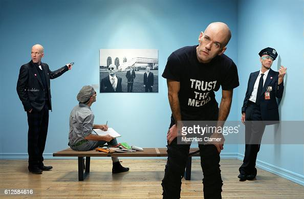 Michael Stipe the singer of REM as four different men in a museum with a photograph of the rock band