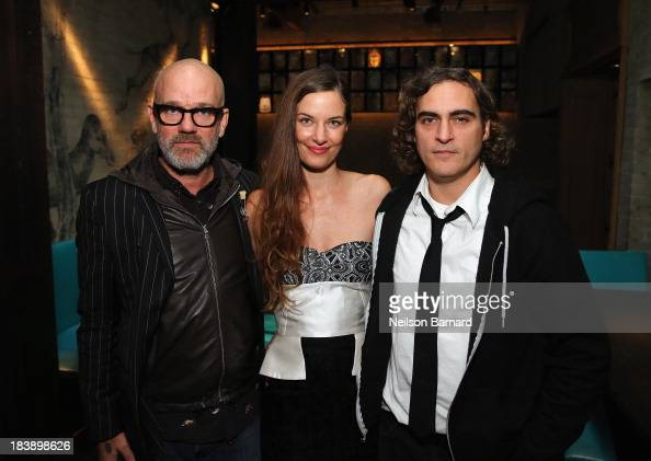 Michael Stipe Topaz PageGreen and Joaquin Phoenix attend The Lunchbox Fund Fall Fête at Buddakan New York on October 9 2013 in New York City