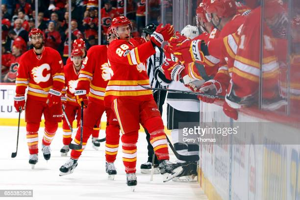 Michael Stone and teammates of the Calgary Flames celebrate a goal against the Los Angeles Kings during an NHL game on March 19 2017 at the...