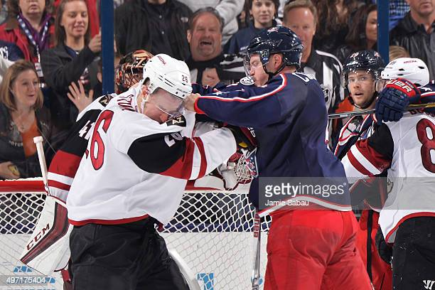 Michael Stone of the Arizona Coyotes and Kevin Connauton of the Columbus Blue Jackets fight during the second period on November 14 2015 at...