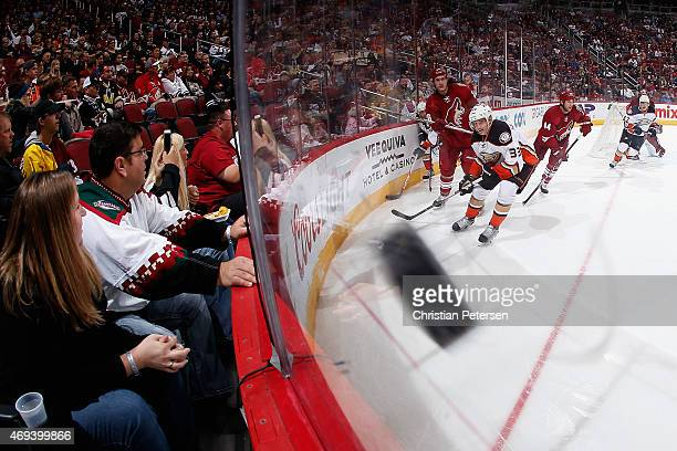 Michael Stone of the Arizona Coyotes clears the puck from Jakob Silfverberg of the Anaheim Ducks during the second period of the NHL game at Gila...