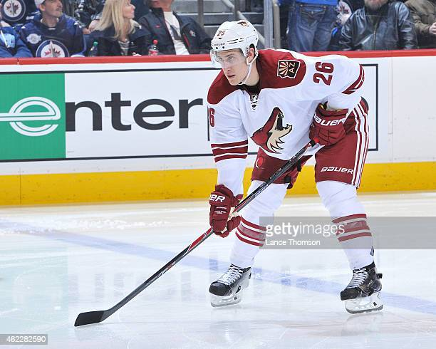 Michael Stone of the Arizona Coyotes gets set during a third period faceoff against the Winnipeg Jets on January 18 2015 at the MTS Centre in...