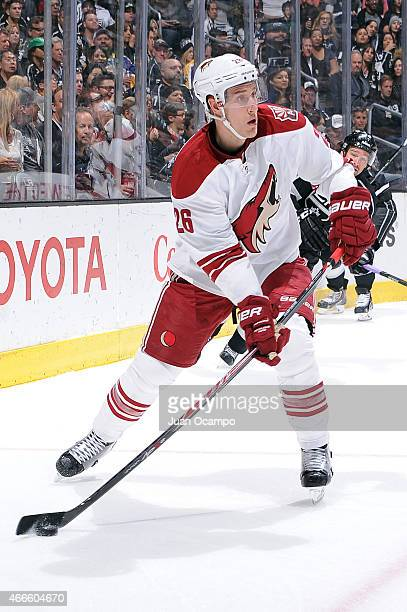 Michael Stone of the Arizona Coyotes handles the puck during a game against the Los Angeles Kings at STAPLES Center on March 16 2015 in Los Angeles...