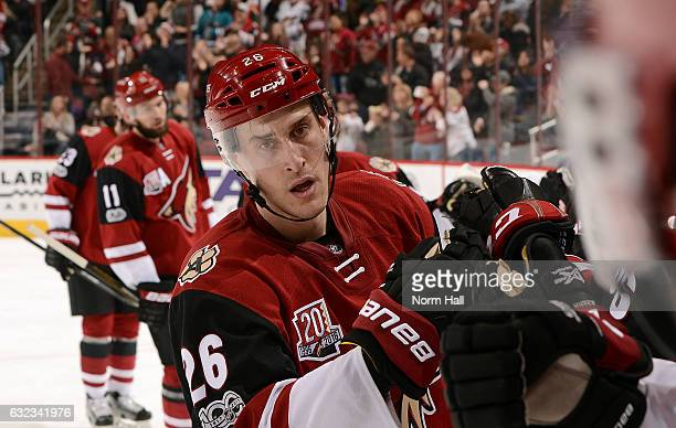 Michael Stone of the Arizona Coyotes is congratulated by teammates after scoring a second period goal against the Tampa Bay Lightning at Gila River...