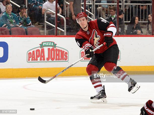 Michael Stone of the Arizona Coyotes passes the puck up ice against the San Jose Sharks at Gila River Arena on March 17 2016 in Glendale Arizona
