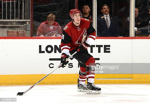 Michael Stone of the Arizona Coyotes skates with the puck against the Calgary Flames at Gila River Arena on February 12 2016 in Glendale Arizona