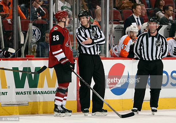 Michael Stone of the Arizona Coyotes talks with linesman Greg Devorski as they review his second period goal against the Philadelphia Flyers at Gila...